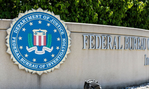 The Federal Bureau of Investigation logo on a building.